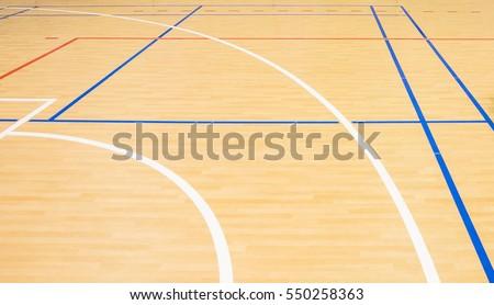 wooden floor volleyball, basketball, badminton court with light effect\ Wooden floor of sports hall with marking lines\ line on wooden floor indoor, gym court