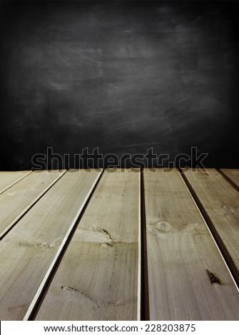 Wooden floorboards and blackboard wall