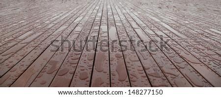 Wooden flooring with rain drops.