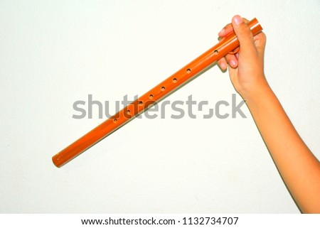 Wooden flute,Brown wood flute (Handmade) white background used for music education of elementary students. #1132734707