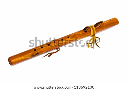 Wooden flute. Replica of ancient musical instruments of North American Indians.