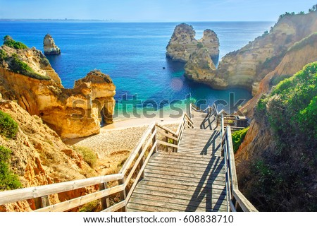 Wooden footbridge to beautiful beach Praia do Camilo near Lagos in algarve region, Portugal #608838710