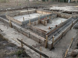 Wooden formwork concrete strip foundation for a cottage.