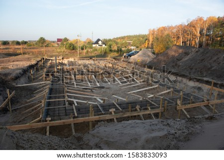Wooden formwork concrete strip foundation for a cottage. Stock photo ©