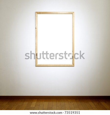 Wooden frame hanging on white wall