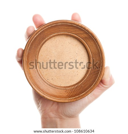 Wooden frame in hand isolated on white background