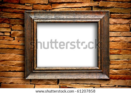 wooden frame on brick wall