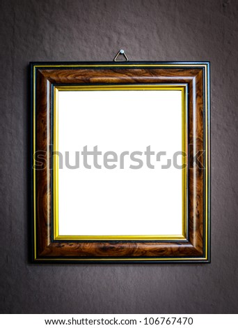 Wooden frame on grunge wall background - stock photo