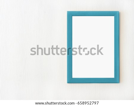 Wooden frame with blank background isolated on white wall. Mock up ...