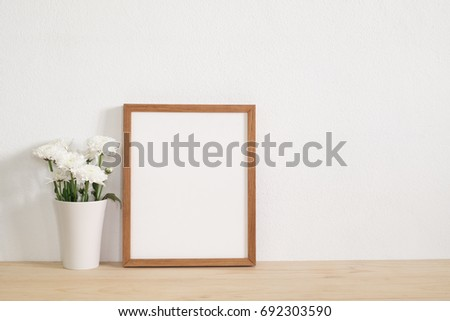 Wooden Frame With White Flower In Vase On Table Home Decoration