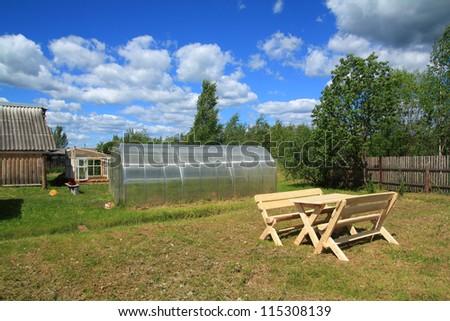wooden furniture in rural garden