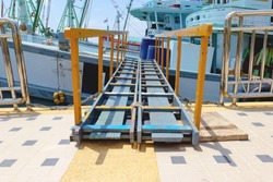 wooden gangway to board fishing boat