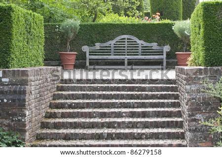 Wooden Garden Bench In English Garden Kent Uk Stock Photo