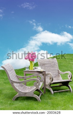 Wooden garden chairs in a surreal and peaceful spot