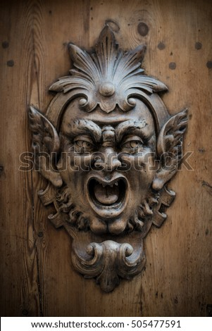 Wooden Gargoyle on old doors