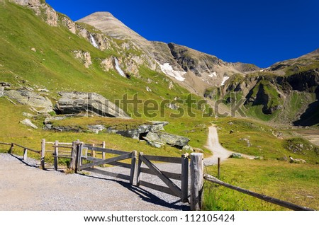 Wooden gate in mountain area of Hohe Tauern National Park, Austria