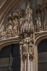 Wooden gate with Gothic sculptures in the Cathedral of St. Michael and St. Gudula at Brussels. The vibrant and friendly capital of Belgium.