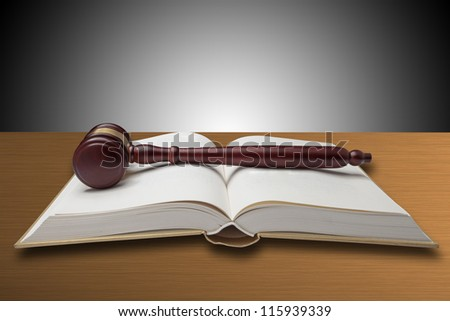 Wooden gavel and book - stock photo