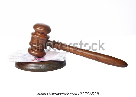 Wooden gavel and euro bills from the court isolated on white background