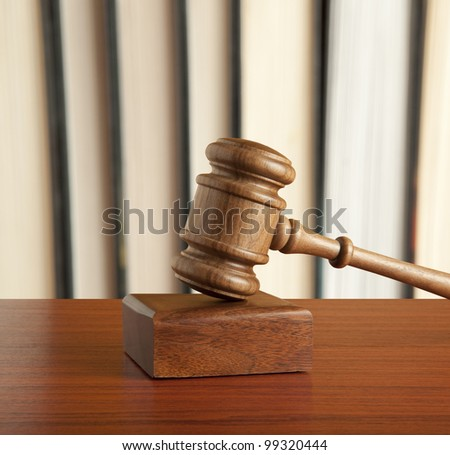 Wooden gavel and old book