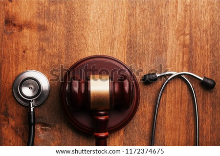 Wooden gavel and stethoscope, close-up view