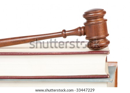 Wooden gavel from the court and law books isolated on white background. Shallow depth of field