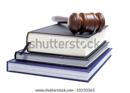 Wooden gavel from the court and law books isolated on white background. Shallow DOF