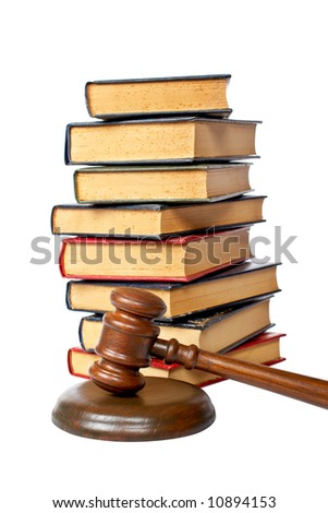 Wooden gavel from the court and old law books isolated on white background. Shallow depth of file