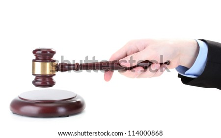 wooden gavel in hand isolated on white