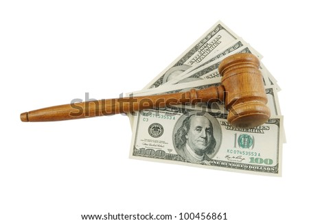 Wooden gavel on dollars isolated on white
