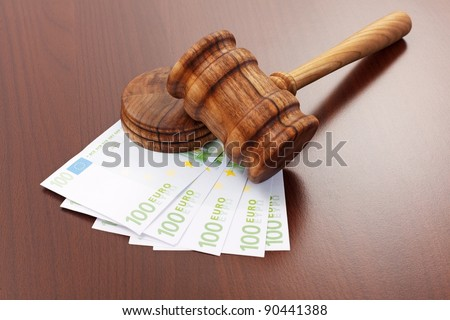 Wooden gavel on euro banknotes. Concept of bribe or corruption in justice