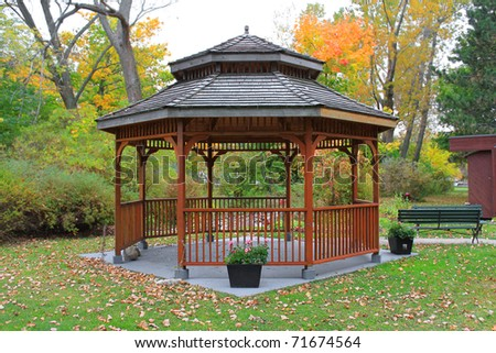 Wooden gazebo surrounded by colorful fall foliage in Toronto Island, Ontario, Canada