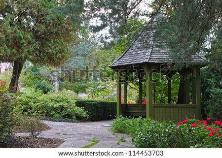 Wooden gazebo surrounded by colorful fall foliage in Toronto park, Ontario, Canada