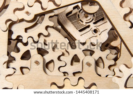 Wooden gearwheels close up. Mechanisms and devices. #1445408171