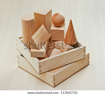 wooden geometric shapes on the table