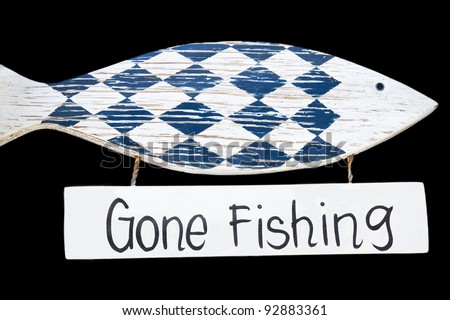 Wooden gone fishing sign, isolated on black background
