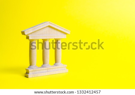 wooden government building on a yellow background. The authorities, the sovereignty of the country and the rule of law. concept of state administration and economic institutions. Bank or university
