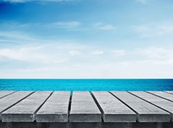 Wooden gray pier on sunny day