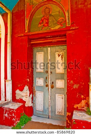 Wooden grey door of an old church in monastery Iviron in holy mountain Athos in Greece