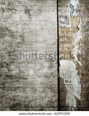Wooden grunge background with pieces of newspapers