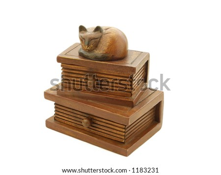 Wooden hand-carved cat asleep on hardback books, trinket/jewelry drawers/box.