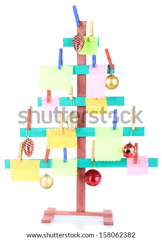 Wooden hand made fir tree with blank papers and Christmas decor, isolated on white