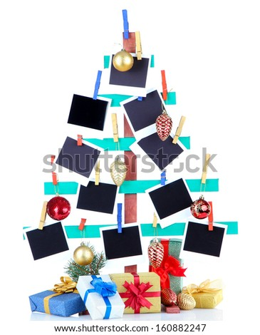 Wooden hand made fir tree with empty photo paper and Christmas decor, isolated on white