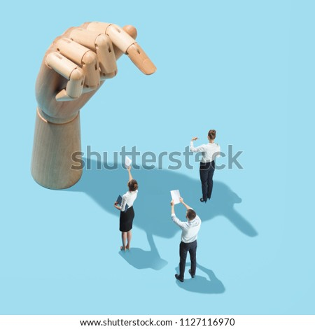 Wooden hand with finger pointing to woman. Flat isometric view. Business processes, recruitment, human resources department concept. Miniature people. Collage