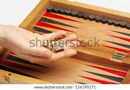 Wooden handmade backgammon board and two dices