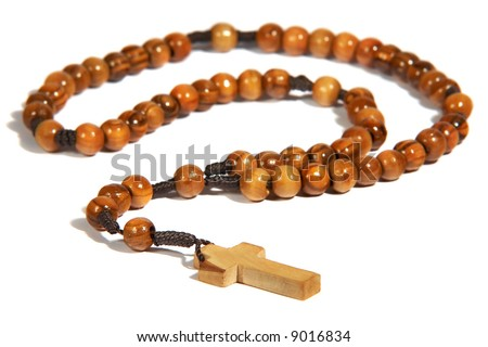 Wooden handmade rosary isolated on the white background