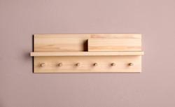 Wooden hanger for keys on color wall