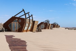 Wooden hats on the desert in Namibia. Shipwreck Lodge