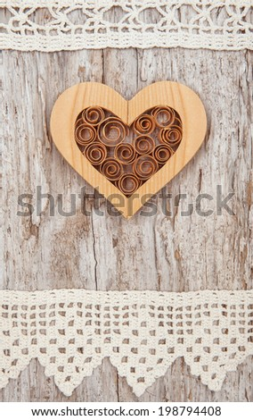 Wooden heart and lace fabric on the old wood #198794408