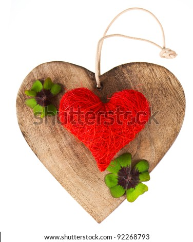 wooden heart and red heart with clover leaves
